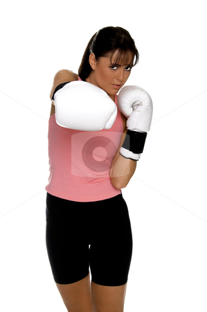 Female Boxer stock photo, Healthy young woman in white boxing  gloves shoots a strong right cross during a boxing workout. by Robert Deal