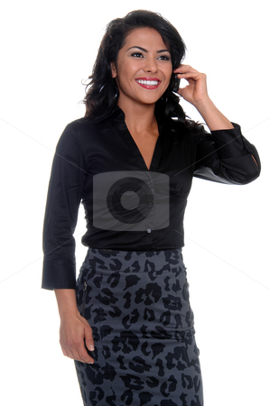 Business Woman On Cell Phone stock photo, Beautiful young latina business woman talking on a cell phone by Robert Deal