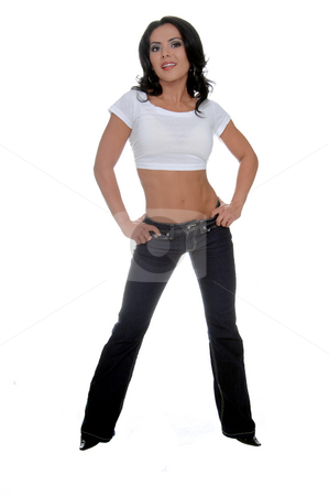 Hispanic woman on white background stock photo, Young female personal fitness trainer in designer jeans and a half t-shirt by Robert Deal
