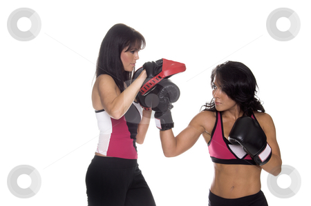 Focus Mitt Training stock photo, Two beautiful female boxers training on focus mitts with the puncher throwing a right uppercut by Robert Deal