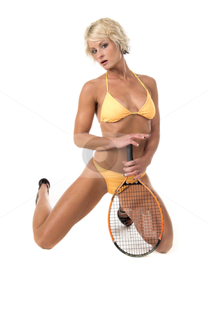 Blond in Yellow Bikini stock photo, Sexy blond swim wear model in a yellow bikini kneeling with a tennis racquet by Robert Deal