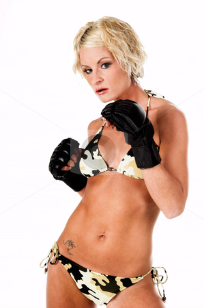 Female MMA Fighter stock photo, Sexy blond mixed martial arts fighter in a camo bikini and MMA style gloves standing in a fight stance by Robert Deal