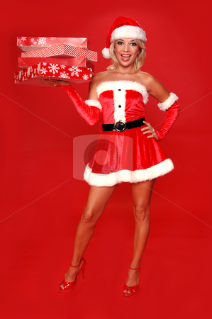 Santa's Christmas Helper stock photo, Santa's sexy helper delivering christmas gifts by Robert Deal