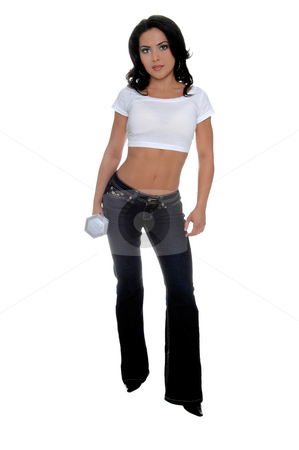 Female fitness Trainer stock photo, Young female personal fitness trainer in designer jeans and a half t-shirt holding a 15 pound dumbell in her right hand by Robert Deal