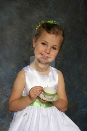 Tea party stock photo, Cute little girl all dressed up holding a tea cup and saucer by Anita Peppers