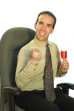 Business Celebration stock photo, A young businessman looking excited and holding a glass of wine by Richard Nelson