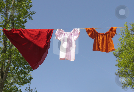 Clothes on a line stock photo, Vintage style clothes hanging on a line by Anita Peppers