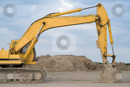 Backhoe stock photo, The scoop of a backhoe, shot against a cloudy sky by Richard Nelson