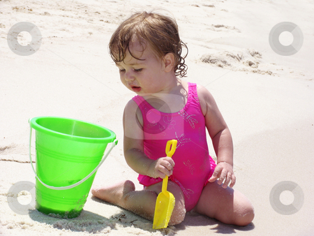 Beach Baby with bucket stock photo,  by Anita Peppers
