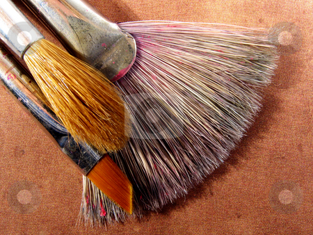 Artist brushes stock photo, Artists' paint brushes on textured background by Anita Peppers