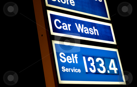 Gas Prices stock photo, Closeup view of a gas station sign showing the price of gas in Canada by Richard Nelson