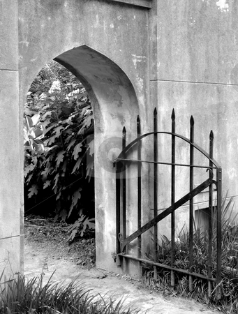 Iron gate stock photo, Stone wall and iron gate by Anita Peppers