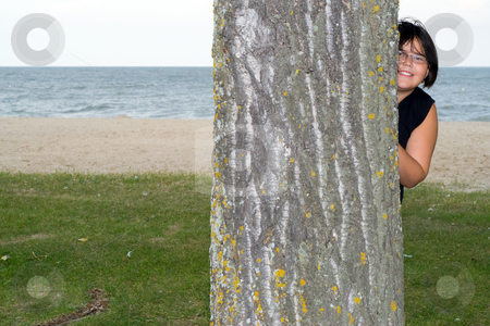 Hide and Seek stock photo, A young girl playing hide and seek at the beach by Richard Nelson