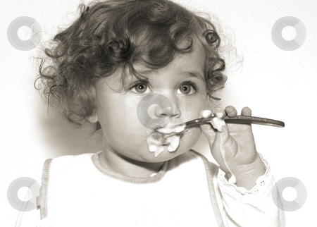 Baby with spoon stock photo, Vintage style black and white of a  messy baby eating with a spoon by Anita Peppers