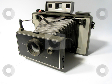 Old camera stock photo, Old fashioned instant type camera on white background by Anita Peppers