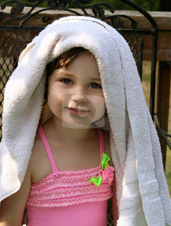 Little girl with towel stock photo, Smiling little girl in pink swimsuit with towel over her hair by Anita Peppers