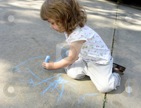 Child drawing on sidewalk stock photo, Pre-school age child drawing on sidewalk with colored chalk by Anita Peppers