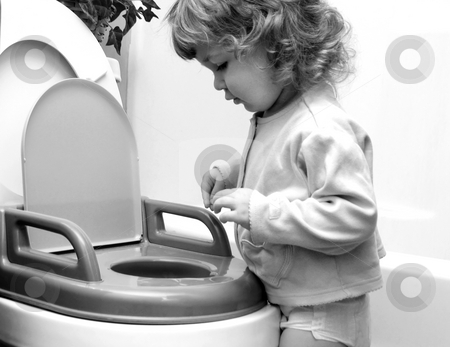 Potty training stock photo, Toddler learning to use the potty by Anita Peppers