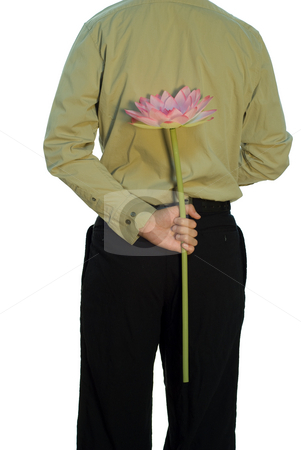 Anniversary stock photo, A man standing with his back to the camera, holding a large flower behind his back by Richard Nelson