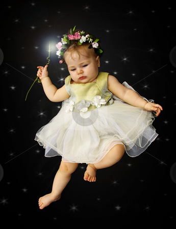 Little fairy stock photo, Little fairy and wand against stars by Anita Peppers