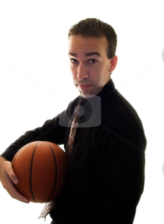 Businessman Holding Basketball stock photo, A businessman holding a basketball under his arm by Richard Nelson