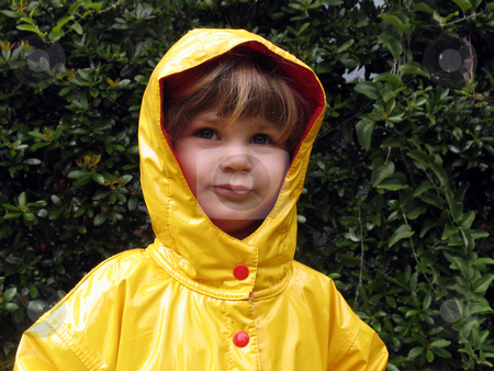 Yellow Raincoat stock photo, Little girl in a yellow raincoat by Anita Peppers