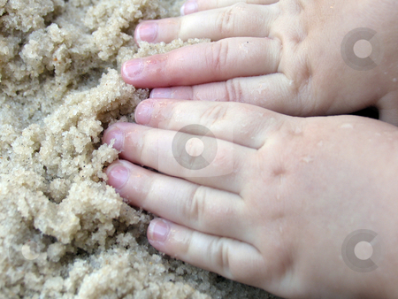 Hands in the sand stock photo, Child's hands playing in the sand by Anita Peppers