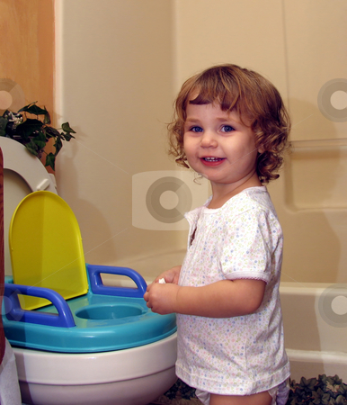 Potty training success stock photo, Toddler smiling next to her potty seat by Anita Peppers