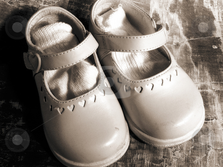 Shoes stock photo, Little girl's shoes with socks by Anita Peppers