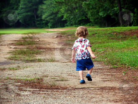 Skipping stock photo, Little girl walking up a dirt road by Anita Peppers