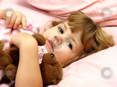 Bedtime stock photo, Little girl tucked in bed with her teddybear by Anita Peppers