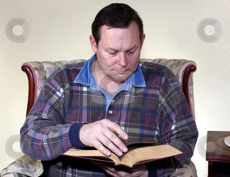 Man reading in armchair stock photo,  by Anita Peppers