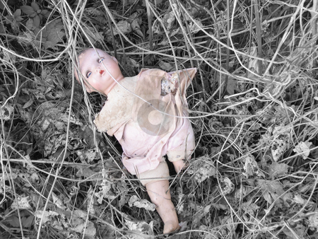 Abandoned stock photo, Old abandoned, broken doll lying in the wood, selective color by Anita Peppers