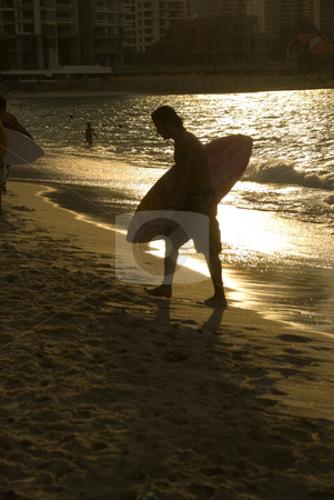 Skin boarding afternoon stock photo, A skin board surfer at the beach by Stefan Breton