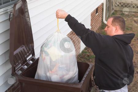 Garbage Man stock photo, A man throwing away garbage. by Robert Byron