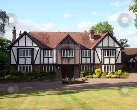 British Tudor Home stock photo, A Large Estate home, tudor style, in the UK. by Lucy Clark