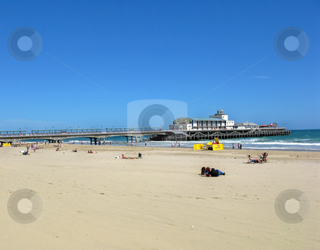 Beach and Pier stock photo, A view of a beach, sea in a pier. by Lucy Clark