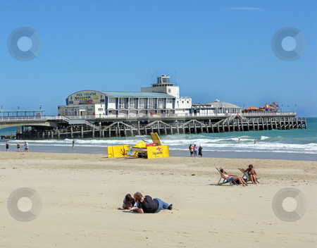 Pier and Beach stock photo, A view of a beach, sea and a pier. by Lucy Clark