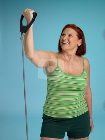 Woman working out stock photo, Senior woman using a resistance band by Mpixis World