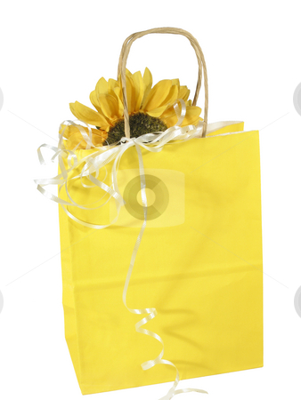 Gift bag yellow stock photo, Cheerful yellow gift bag with sunflower isolated on white by Anita Peppers