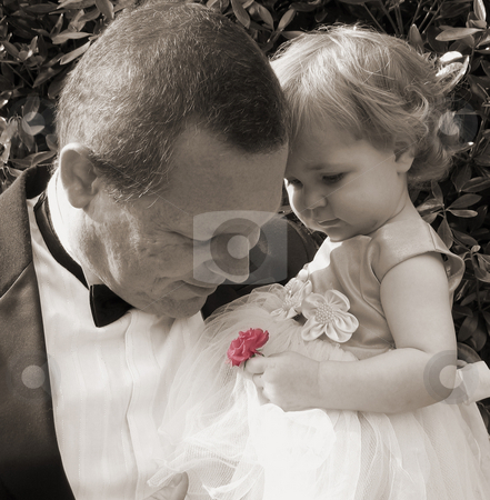 Smelling the Roses stock photo, Man in tuxedo smells colorized rose held by flower girl by Anita Peppers