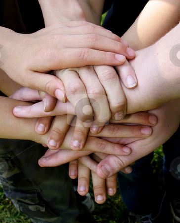 Teamwork2 stock photo, Boys' team with hands stacked together by Anita Peppers