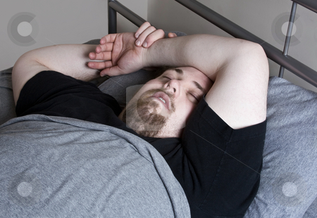 Large man snoring  stock photo, Large man asleep in bed, snoring by Anita Peppers