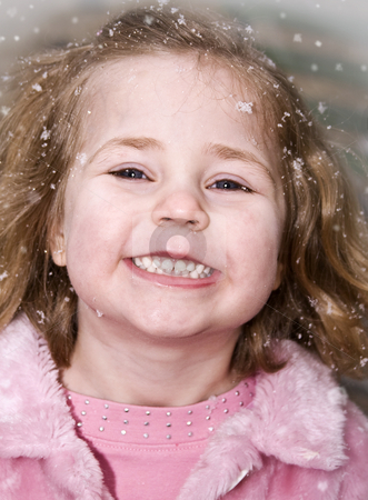 Frosty girl stock photo, Happy little girl with snowflakes around her face by Anita Peppers