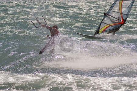 In the wind stock photo, Winder surfer and kite boarder during a windy day in French Riviera by Serge VILLA