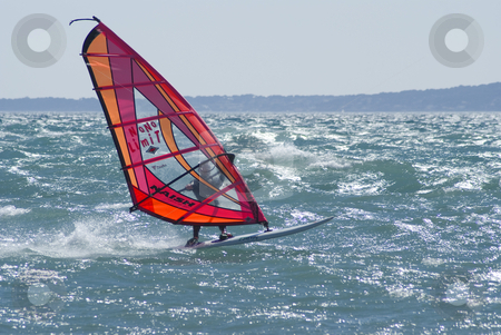 In the wind stock photo, Winder surfer at full speed during a windy day by Serge VILLA