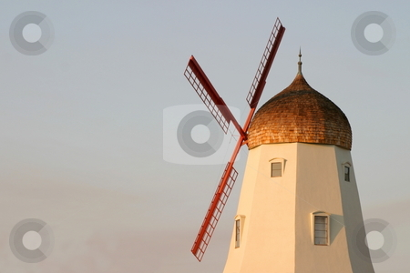 Old Windmill stock photo, Old windmill with colors from a sunset by Henrik Lehnerer