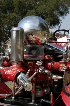 Old Fire Truck stock photo, Close up of an old red fire truck. by Henrik Lehnerer