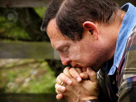 Man in prayer stock photo, Man in prayer color version by Anita Peppers