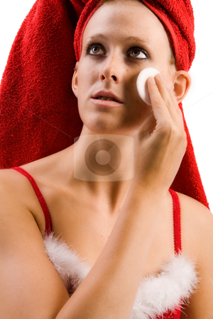 Beautiful wellness girl cleansing her face stock photo, Studio portrait of a beautifull girl who is moisturizing her face by Frenk and Danielle Kaufmann